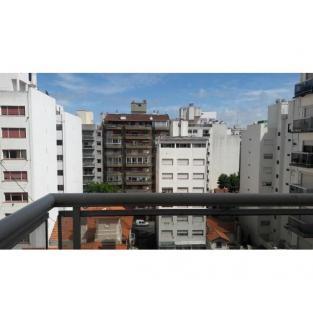 *Un ambiente con balcon*
